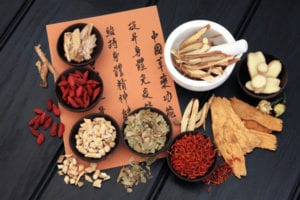 Overhead shot of Chinese herbal medicine and Chinese calligraphy